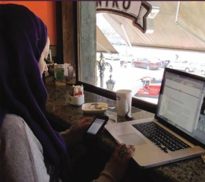 The cover picture from the Middle Easter edition of Connected in Cairo features an Arab woman in a coffee shop using smart phone and laptop. What does the emergence of blogging as a new literary genre mean for the region?