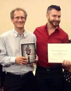 "Richard Schroeder (left) presented Paul Amar with the Charles Taylor book award for ""The Security Archipelago"" which looks at (among other things) the changing security state, and resistance to it, and its abilities to counter that resistance, in Egypt."